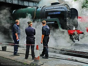"""Cleaners admiring their work.""</strong> The role of Locomotive Cleaner is the first rung on the ladder for aspiring steam footplate crews of the future. - Photo © Graham Wignall."