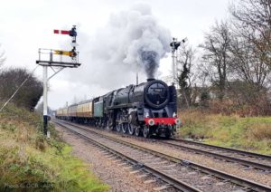 """70013 Oliver Cromwell steams away from Loughborough Central on Christmas Day 2018."" Taken in the same location as our image from earler today of Littleton Number 5, we see how much has changed in four decades. 70013 appears courtesy of the National Railway Museum. - Photo © Great Central Railway / AJM."