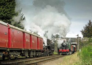 """The busy approaches to a station are graced by two superb 4-6-0s hauling vans and postal."" - Photo © John Smith."
