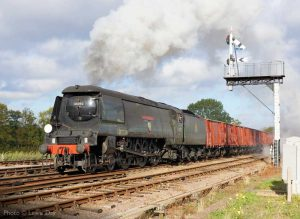 """""""Assorted vans for destinations many, hauled onwards by a Bulleid Light Pacific."""" - Photo © Lewis Day."""