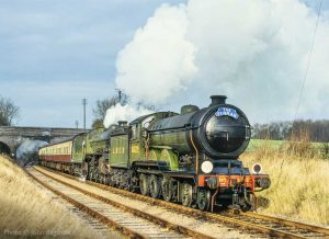 """""""B12 and B1 are resplendent in LNER colours as they haul a passenger train through the Leicestershire countryside. - Photo © John Bagshaw."""