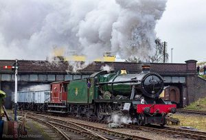 """""""Feeding the boilers of bygone industry... 6990 Witherslack Hall works a short coal train through a busy town station."""" - Photo © Alan Weaver."""