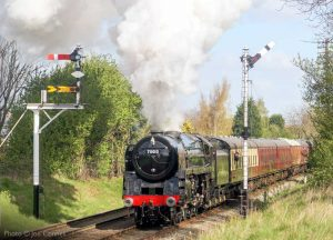 """""""With power in reserve, 70013 'Oliver Cromwell' accelerates away from Loughborough Central."""" 70013 appears courtesy of the National Railway Museum. - Photo © Joe Connell."""