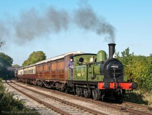 """""""The smart apple green livery of J72 69023 brightens the day while hauling a short passenger train."""" This North Eastern Railway inspired livery was originally applied to two members of the class by British Railways in the early 1960s, for use on station pilot duties at Newcastle and York. - Photo © Stephen Bottrill."""
