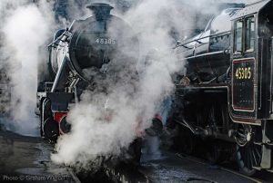 """""""Giants prepare... Two of Stanier's finest locomotives are made ready for the day's duties."""" - Photo © Graham Wignall."""