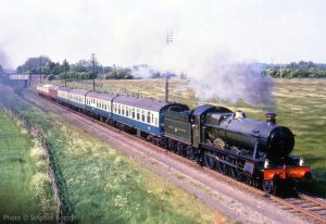 """""""Looking back to earlier times in the preservation era, 6990 'Witherslack Hall' works a passenger train from Loughborough before the reinstatement of double-track."""" - Photo © Stephen Bottrill."""