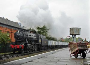 """""""A coal train trundles through the loop to await a path on the main line."""" - Photo © Stephen Bottrill."""