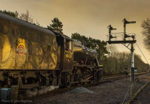 """The light of the sunset creates an impressive stage for a passing Stanier Class 8."" - Photo © John Bagshaw."