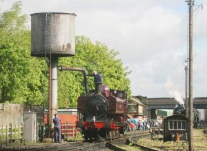 """""""Thirsty work for locos and crew alike. London Transport liveried pannier tank L92 (5786) takes water at Loughborough Central."""" - Photo © Joe Connell."""