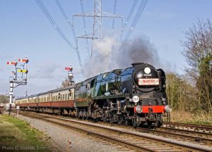 """An express thunders on towards the south, with Bulleid Light Pacific in charge."" - Photo © Stephen Bottrill."