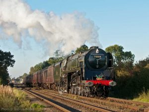 """71000 'Duke of Gloucester' leads a passenger train on its journey through the British countryside."" - Photo © Stephen Bottrill."