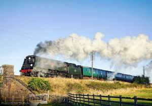 """""""On the approaches to Quorn & Woodhouse, a passenger train steams southwards."""" - Photo © Ian Duffield."""