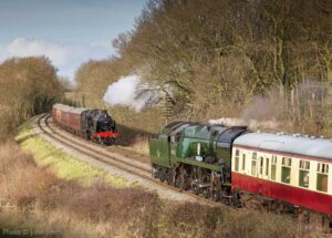 """""""Passing trains in sight, with U Class and Battle of Britain Class locomotives hauling their respective Southern Region workings."""" - Photo © John Smith."""