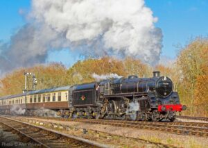 """""""In bright sunshine, 73156 steams into the Up Loop at Swithland Sidings with a passenger train."""" - Photo © Alan Weaver."""