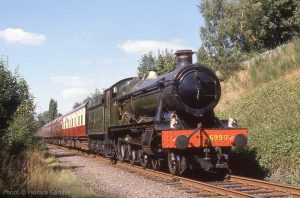 """""""In the days before the return of double track, 6990 'Witherslack Hall' approaches Rothley with a passenger train."""" - Photo © Horace Gamble."""