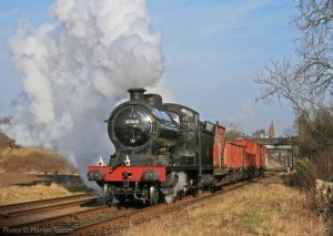 """""""Steaming forward on a bright Leicestershire morning, O4 63601 works a short mixed goods train away from Loughborough."""" O4 63601 appears courtesy of the National Railway Museum. - Photo © Martyn Tattam."""