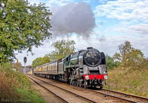 """""""The South Yorkshireman makes good progress through the Leicestershire countryside with a BR Standard Class 9F in charge."""" - Photo © Syd Hancock."""