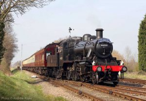"""""""Across the road... Ivatt Class 2 46521 crosses from Down Main to Up Main line at Quorn & Woodhouse, with Brush Type 2 D5830 at the rear of the train."""" - Photo © Andrew Royle."""