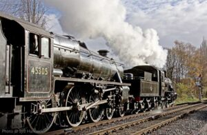 """""""BR Standard Class 2 pilots Stanier Class 5 towards Rothley in the early evening sunshine."""" - Photo © Syd Hancock."""