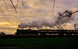 """""""B12 8572 of the London and North Eastern Railway works a passenger train into the picturesque sunset."""" - Photo © Stephen Bottrill."""