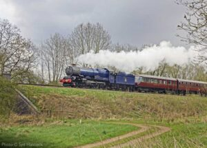 """""""An ex-GWR King appearing in blue livery from the early days of British Railways, adds colour to a dull day."""" - Photo © Syd Hancock."""