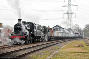 """""""With shunting completed, a pair of Class 2MTs prepare to work a coal train on the next stage of its journey, while a Stanier Class 8 draws away from the far end of the train."""" - Photo © Peter Salmon."""