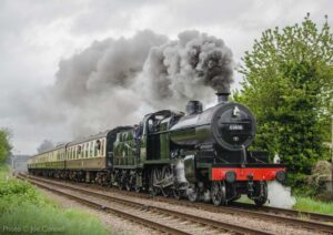 """""""7F power... An ex-Somerset and Dorset Joint Railway 7F 2-8-0 has power in reserve while hauling a passenger train for the south."""" - Photo © Joe Connell."""