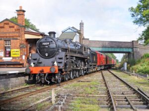 """""""Delivering the mail... BR Standard Class 5 73129 with Caprotti valve gear rushes through Quorn & Woodhouse with the Travelling Post Office."""" - Photo © Peter Salmon."""