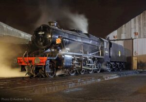 """""""A giant of steam rests in the cool evening air... Stanier Class 8 48624 pauses on shed after a busy day of work."""" - Photo © Andrew Royle."""