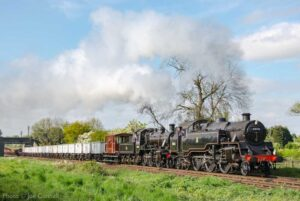 """""""Two well-regarded BR Standards share the load of a heavy goods train steaming through the Leicestershire countryside."""" - Photo © Joe Connell."""