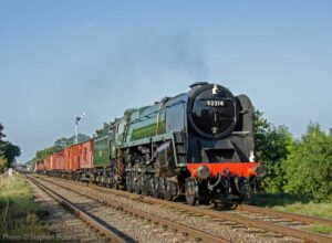 """""""Freight on its way... A BR Standard Class 9F hauls a mixed freight towards the south, having just passed through Quorn & Woodhouse."""" - Photo © Stephen Bottrill."""