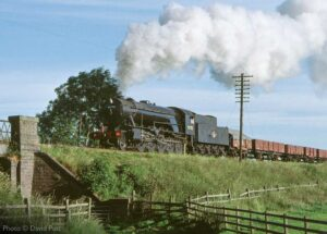 """""""Heavy freight on the Great Central... A WD Austerity 2-10-0 steams towards Quorn & Woodhouse with a mixed freight."""" - Photo © David Putt."""