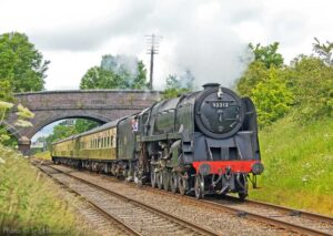 """""""The camera captures a visiting 9F on passenger train duty during a pleasant afternoon in Leicestershire."""" - Photo © Syd Hancock."""