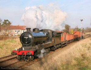 """""""Always a popular sight... O4 63601 hauls a short mixed freight train away from Loughborough Central in pleasant sunshine."""" 63601 appears courtesy of the National Railway Museum. - Photo © Neville Wellings."""