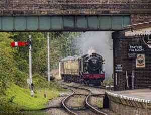 """""""A distant view of approaching steam... 6990 'Witherslack Hall' approaches Quorn & Woodhouse with a passenger train."""" - Photo © Stephen Bottrill."""