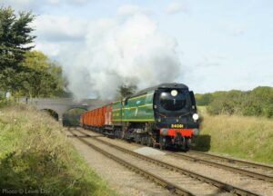 """""""Southern freight on show with a Bulleid Light Pacific working a van train through picturesque countryside."""" - Photo © Lewis Day."""