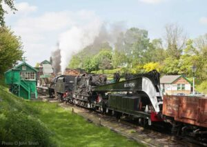 """""""Train 1Z99 takes priority through Rothley... A Stanier Class 8 hurries northwards with a demonstration breakdown train."""" - Photo © John Smith."""