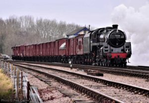 """""""A popular mixed-traffic giant of steam... BR Standard Class 5 73156 thunders through Swithland Sidings with a goods train."""" - Photo © Paul Callow."""
