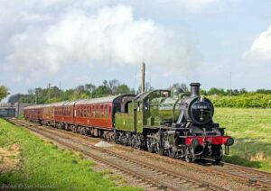 """""""The green livery of Swindon-built Ivatt Class 2 46521 adds colour to a pleasant scene in the Leicestershire countryside."""" - Photo © Syd Hancock."""