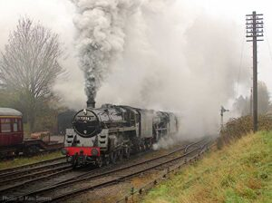 """""""Despite inclement weather, two generations of Class 5 locomotive create an impressive scene on departure from Loughborough Central."""" - Photo © Ken Simms."""