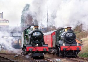 """""""A Western Region theme at Loughborough Central as Hall prepares to haul the next passenger train, while Manor waits with the Travelling Post Office."""" - Photo © Martyn Fisher."""