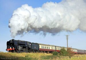 """""""The magic of the steam locomotive... BR Standard Class 9F 92203 creates an impressive scene while hauling a passenger train on the Great Central."""" - Photo © Andy Bennett."""