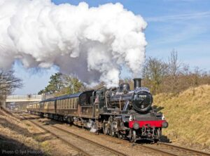 """""""The South Yorkshireman lunchtime dining train steams on, with 78018 in charge."""" - Photo © Syd Hancock."""
