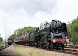 """""""Double track in action... 9F 92214 steams forward with a southbound passenger train, while a goods train heads north."""" - Photo © Roy Harris."""