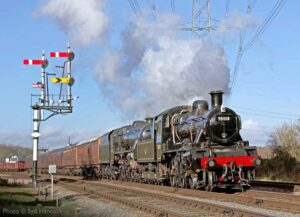 """""""BR Standard Class 2 78018 pilots Stanier Class 5 45305 through Swithland Sidings with a passenger train, in bright sunshine."""" - Photo © Syd Hancock."""