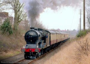 """Looking back to the early 1990s, Great Central Railway Improved Director Class 506 'Butler Henderson', pictured carrying later British Railway number 62660, steams away from Loughborough Central with a passenger train."" 506 ""Butler Henderson"" is owned by the National Railway Museum. Photo © Neville Wellings."