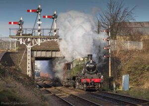 """Built for mixed traffic work... Ivatt Class 2MT 46521 powers away from Loughborough Central with a short mixed freight."" - Photo © John Smith."