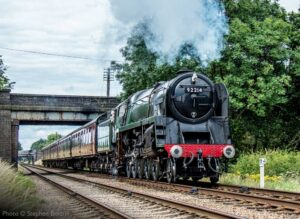 """British Railways Standard Class 9F 92214 passes Milepost 94 between Loughborough Central and Quorn & Woodhouse on the Great Central."" - Photo © Stephen Bottrill."