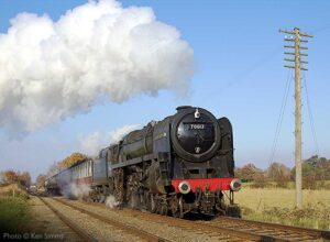 """70013 'Oliver Cromwell' delivers an impressive display while ascending the gentle 1-in-176 gradient towards Quorn & Woodhouse."" 70013 ""Oliver Cromwell"" appears courtesy of the National Railway Museum. - Photo © Ken Simms."