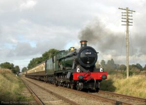 """6990 'Witherslack Hall' thunders along the straight towards Quorn & Woodhouse with an express."" - Photo © Ken Simms."
